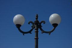 Street lamp shade. In the city Royalty Free Stock Photo