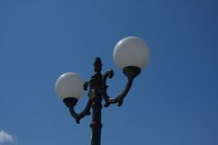 Street lamp shade. In the city Royalty Free Stock Image