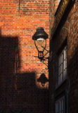 Street lamp with shade between historic  brick walls in the Hans Royalty Free Stock Image