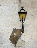 Street lamp with shadow. On the old wall Stock Photos