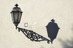 Street lamp with shadow. On the old wall Stock Image