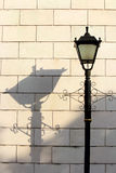 Street lamp and shadow. In the picture Stock Images