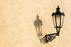 Street lamp with shadow in Prague Royalty Free Stock Images
