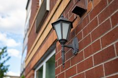 Street lamp on the building stock image