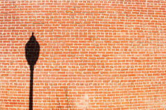 Street Lamp Silhouette on cracked brick wall Stock Photo