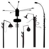Street lamp silouettes Stock Photos