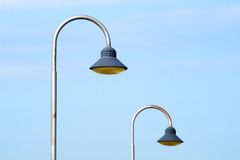 Street lamp and sky during daylight with two lamps in background. Royalty Free Stock Photography
