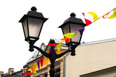Street lamp and small decorative flags isolated Stock Photography