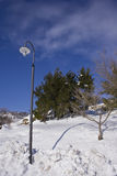 Street lamp in a snowy hill Royalty Free Stock Image