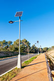 Street Lamp with Solar Panel. In a row Royalty Free Stock Photos