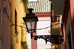 Street lamp in the city of Seville. Street lamp in the Spanish city of Seville. Narrow street. Forged lantern rim Stock Photography