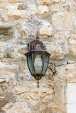 Street lamp on the stone wall in old Budva, Montenegro Royalty Free Stock Photography