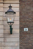 Street lamp and street number Stock Photography