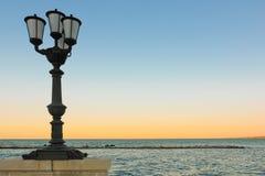 Lungomare Sauro Nazario.Bari. Apulia or Puglia. Italy. Street lamp at sunset in Lungomare Sauro Nazario. Bari. Apulia or Puglia. Italy royalty free stock photos