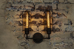 Street lamp. On a textured brick wall Stock Image