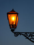 Street lamp turned on Stock Images