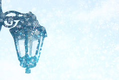 Street lamp. Vintage street lamp, and silver and white bokeh defocused lights with snowflake . abstract background Stock Images
