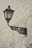 Street lamp. On the wall Stock Images