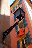 Street lamp and wall with open shutters, Nice Stock Photography