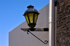 Street lamp and a water pipe in colonia del sacramento Royalty Free Stock Photo
