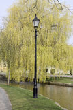 Street Lamp and Weeping Willow Bourton on the Water Stock Images