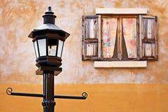 Street lamp and window Stock Photos