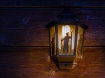 Street lamp on a wooden brown wall. Royalty Free Stock Photography