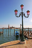Street lamppost and Grand Canal in Venice. Royalty Free Stock Photo