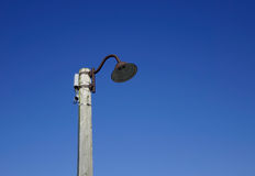 Street lamppost under blue sky in the winter. A street lamppost under blue sky in the winter Royalty Free Stock Photos