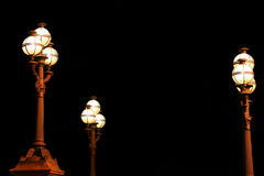 Street Lamps. Classic style street lamps in front of some old building royalty free stock photography