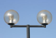Street lamps. A two-beam street lamps with large, spherical glass bodies Royalty Free Stock Image