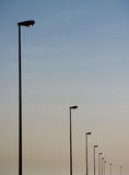 Street lamps. A minimalistic composition of urban street lamps silhouette stock images