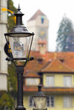 The street lamps against the background of an ancient tower, Luc Royalty Free Stock Images