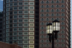 Street lamps against buildings Stock Photos