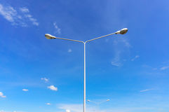 Street lamps aligned with blue sky Royalty Free Stock Photography