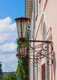 Street lamps on building forging Royalty Free Stock Photography