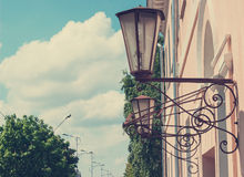 Street lamps on building forging Stock Image
