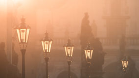 Street lamps on Charles bridge illuminated by sun in the morning, Old Town, Prague, Czech Republic Royalty Free Stock Photography