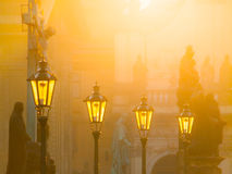 Street lamps on Charles bridge illuminated by sun in the morning, Old Town, Prague, Czech Republic Royalty Free Stock Photos