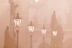 Street lamps on Charles bridge illuminated by sun in the morning, Old Town, Prague, Czech Republic Stock Images