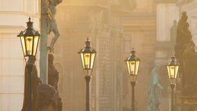Street lamps on Charles bridge in the morning Prague Stock Photos