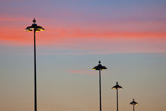 Street lamps at dawn Royalty Free Stock Images