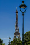 Street lamps and the Eiffel Tower in Paris Royalty Free Stock Photography