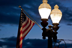 Street lamps and a flag Stock Photos