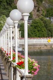 Street lamps and flower pots along river Lahn bank, Bad Ems Stock Photos