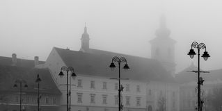 Street Lamps on a foggy day in a medieval city of Sibiu, Transylvania Stock Photography