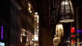 Street lamps near the restaurant slowly swaying stock video footage