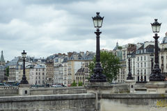 Street lamps over traditional Parisian architecture Royalty Free Stock Image