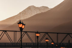 Street lamps in the rays of the setting sun. Street lights in the rays of the setting sun in the mountains Royalty Free Stock Image