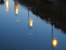 Street lights blurred reflection on water at night Stock Photo
